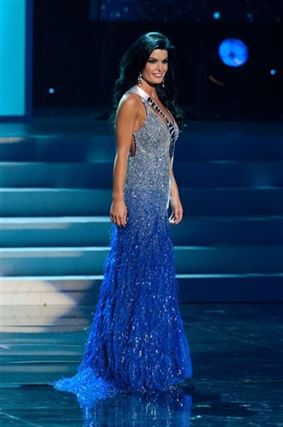 In this photo provided by the Miss Universe Organization, Miss Pennsylvania Sheena Monnin competes during the 2012 Miss USA Presentation Show on Wednesday, May 30, 2012 in Las Vegas. Monnin resigned her crown claiming the contest is rigged, but according to organizers the beauty queen was upset over the decision to allow transgender contestants to enter. A posting on Monninís Facebook page claims another contestant learned the names of the top 5 finishers on Sunday morning, hours before the show was broadcast. (AP Photo/Miss Universe Organization, Darren Decker) Miss USA 2012;Presentation Show;Evening Gown