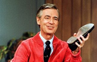 """This June 28, 1989 file photo shows Fred Rogers as he rehearses the opening of his PBS show """"Mister Rogers' Neighborhood"""" during a taping in Pittsburgh. Rogers, the late host of """"Mister Rogers Neighborhood,"""" is featured in a PBS Digital Studios video mashup that celebrates the power of imagination. The piece turns clips from Rogers show into a sweetly inspiring music video, """"Garden of Your Mind."""" A PBS spokesman says the video posted Friday on PBS Digital Studios' YouTube channel is intended to get people talking about public television. More such tribute mashups are planned, spokesman Kevin Dando said. (AP Photo/Gene J. Puskar, File)"""
