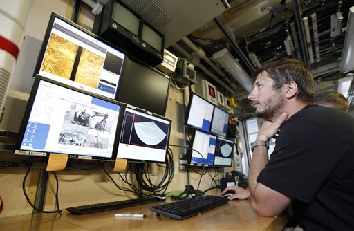 Survey tech David Moehl looks over data during a test of a new side scan sonar system aboard the Ferdinand R. Hassler in Norfolk, Va. The federal research vessel that will help update nautical charts on the East Coast will be commissioned on Friday.