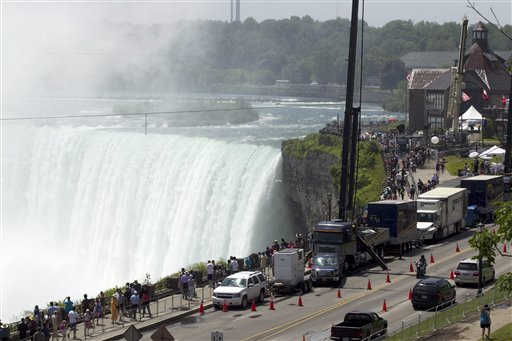 Spectators and media gather as the tightrope that Nik Wallenda will use stretches over Niagara Falls today. Conditions appear good leading up to the nationally televised stunt scheduled for tonight.