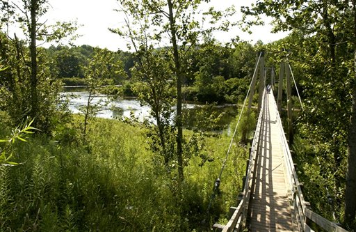 A suspension bridge carries the North Country Scenic Trail over the Manistee River southeast of Mesick, Mich.