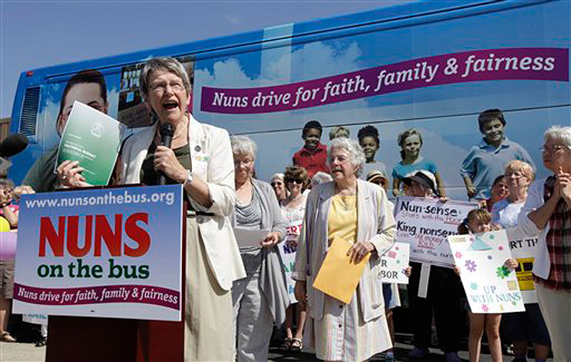 Sister Simone Campbell, executive director of Network, speaks during a stop on the first day of a 9-state Nuns on the Bus tour, Monday, June 18, 2012, in Ames, Iowa. The group of Roman Catholic nuns say theyíre not opposing any particular candidate but that their fight is with a Republican proposed federal budget they say hurts the poor and needy. (AP Photo/Charlie Neibergall)