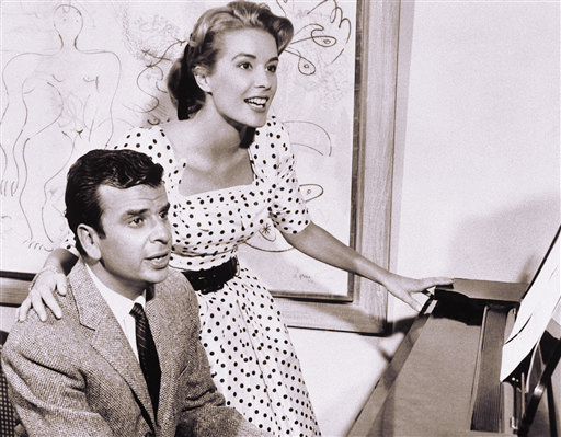 This Sept. 8, 1961, photo shows Richard Adler, left, and his wife, actress-singer Sally Ann Howes, in New York.