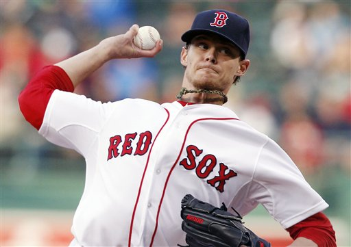 Boston Red Sox starting pitcher Clay Buchholz pitches against the Baltimore Orioles in Boston on Thursday. Buchholz went nine innings, and the Red Sox won, 7-0.