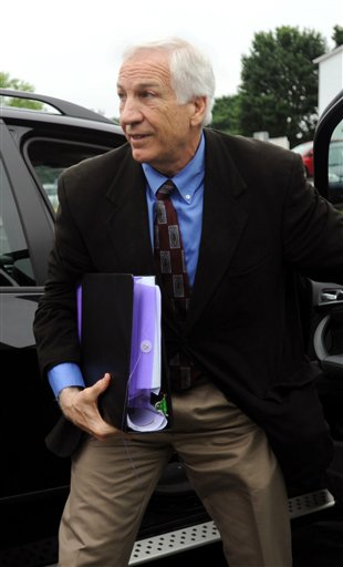 Jerry Sandusky arrives the courthouse for the second week of his trial at the Centre County Courthouse, in Bellefonte, Pa., Monday, June 18, 2012. (AP Photo/Centre Daily Times, Nabil K. Mark)