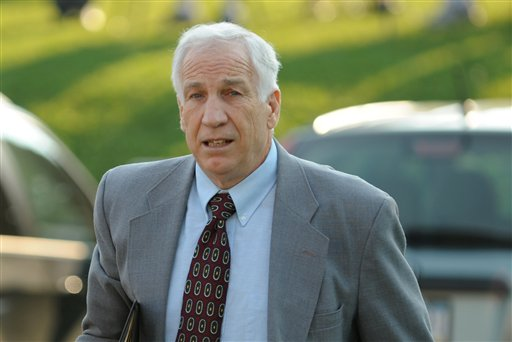 Jerry Sandusky arrives today at the Centre County Courthouse, in Bellefonte, Pa. He is charged with 48 counts related to 10 boys over 15 years. He has repeatedly denied the allegations.