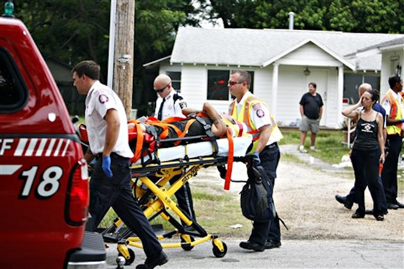 A person reportedly injured by Anthony Giancola is wheeled to a waiting ambulance, in Lealman, Fla., Friday, June 22, 2012. Authorities said Giancola, an ex-Tampa Bay-area middle school principal who lost his job over a drug arrest five years ago, went on a rampage Friday, stabbing several people, killing at least two. Authorities said there were 11 victims in all, and several are being treated at area hospitals for injuries ranging from minor to life-threatening. (AP Photo/Tampa Bay Times, Melissa Lyttle)