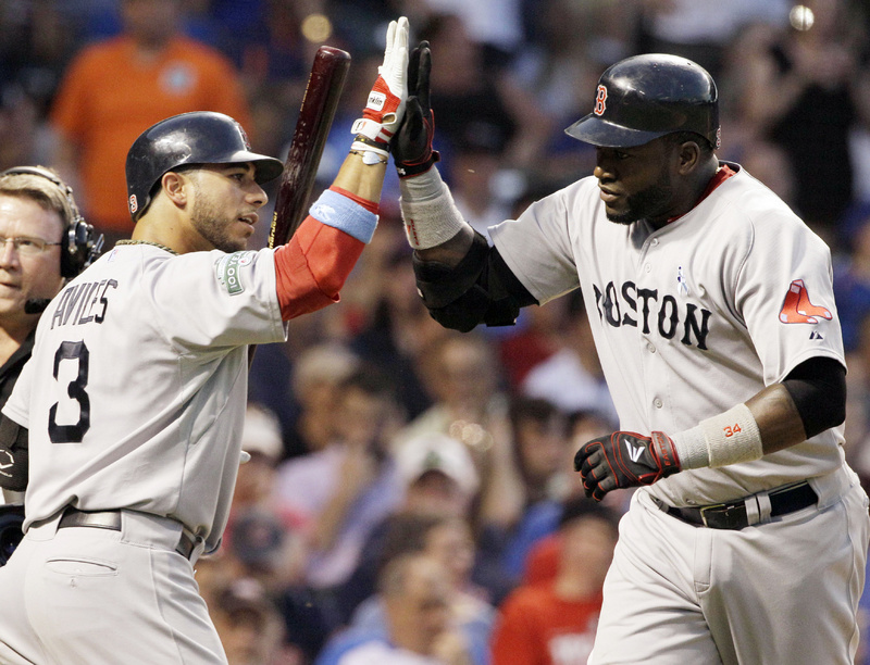 David Ortiz celebrates with Mike Aviles after hitting a solo home run in the fourth inning against the Chicago Cubs on Sunday in Chicago.