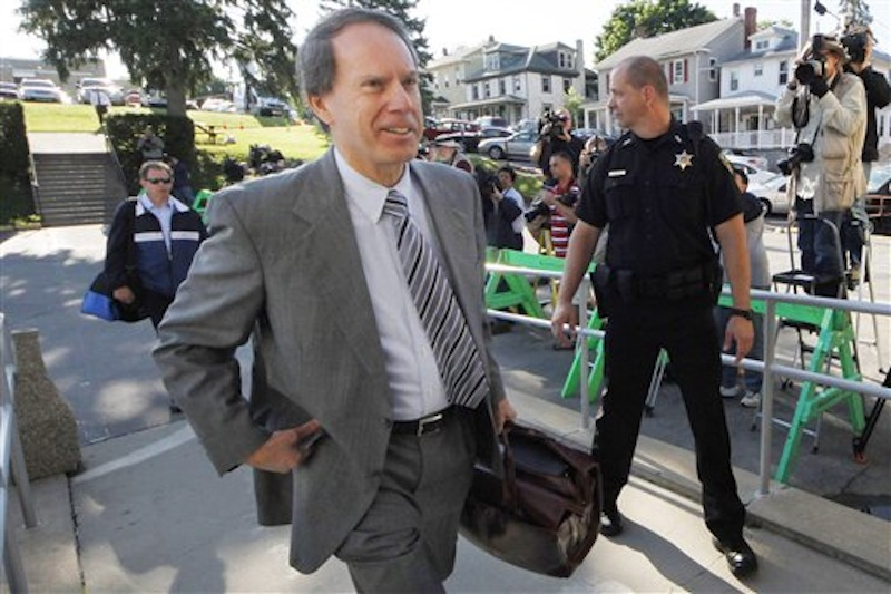 Former Penn State University assistant football coach Jerry Sandusky's attorney Joe Amendola, center, arrives for the second day of jury selection as his trial on 52 counts of child sexual abuse involving 10 boys over a period of 15 years gets underway at the Centre County Courthouse in Bellefonte, Pa., Wednesday, June 6, 2012. (AP Photo/Gene J. Puskar)