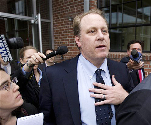 Former Boston Red Sox pitcher Curt Schilling departs the Rhode Island Economic Development Corporation headquarters, in Providence, In this May 16, 2012, photo.