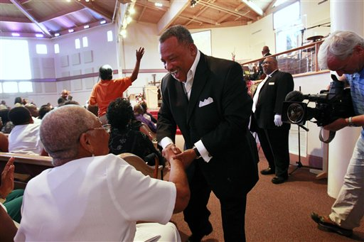 The Rev. Fred Luter, pastor of the Franklin Avenue Baptist Church in New Orleans, greets congregation members during Sunday services.