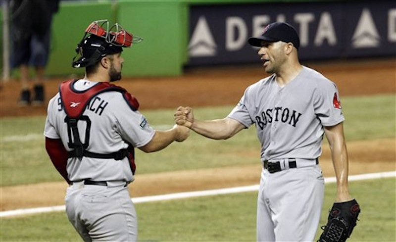 Boston Red Sox relief pitcher Alfredo Aceves, right, is congratulated by catcher Kelly Shoppach after Boston's 2-1 win against the Miami Marlins during an interleague baseball game in Miami, Tuesday, June 12, 2012. (AP Photo/Alan Diaz)