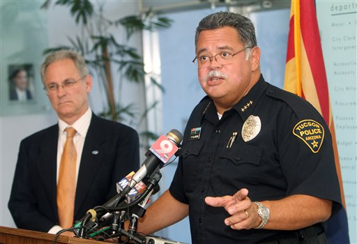 Tucson, Ariz., Mayor Jonathan Rothschild, left, listens to Tucson Chief of Police Roberto Villase during a news conference following the U.S. Supreme Court's ruling on Monday.