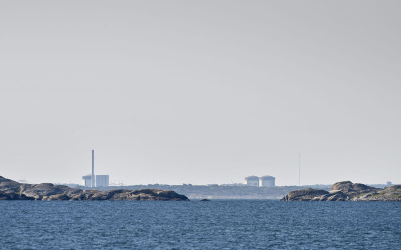 The Ringhals atomic power station near Varberg Sweden seen in the distant Thursday June 21, 2012 .Sweden on Thursday raised the security level for the country's nuclear power plants as police investigated suspected sabotage after explosives were found on a truck at the southwestern atomic power station Ringhals. Police said that bomb sniffer dogs detected the explosives during a routine check as security staff carried at an industrial area within the power plant's enclosure on Wednesday afternoon.