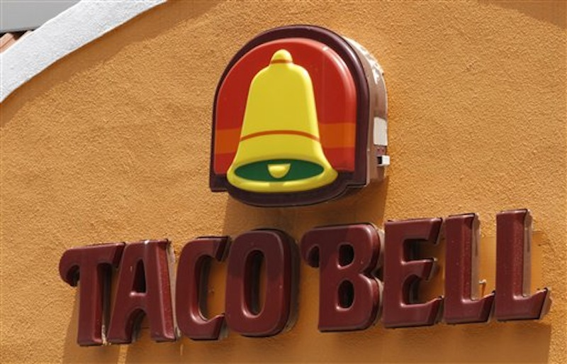 This Wednesday, June 6, 2012, file photo shows a Taco Bell restaurant in Richmond, Va. After a hoax had residents of Betlhel, Alaska thinking they would soon be getting Taco Bell, executives for the chain restaurant have arranged to fly enough ingredients from Anchorage to make 10,000 free tacos for a feast on Sunday, July 1, 2012. The city of 6,200 people is about 40 miles inland from the Bering Sea in far western Alaska, and the closest fast food other than a Subway sandwich shop is in Anchorage, 400 miles and a $500 round-trip plane ticket away. (AP Photo/Steve Helber, File)