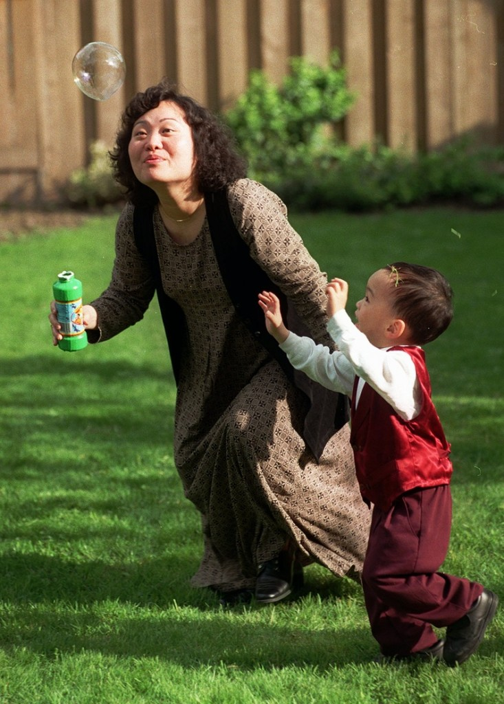 Phan Thi Kim Phuc plays with her son Thomas Huy Hoang in Toronto in 1997.