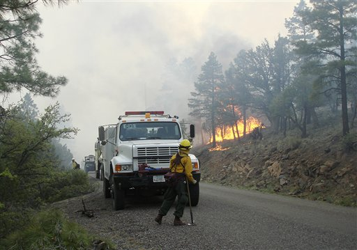Firefighters work an area along the northwest perimeter of a massive blaze in the Gila National Forest in an isolated mountainous area of southwestern New Mexico.