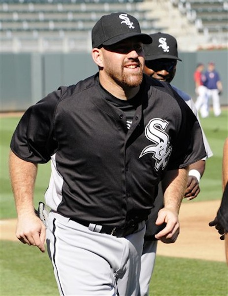 New Chicago White Sox third baseman Kevin Youkilis runs during warmups prior to a baseball game against the Minnesota Twins, Monday, June 25, 2012, in Minneapolis. Youkilis was traded to the White Sox on Sunday from the Boston Red Sox. (AP Photo/Jim Mone)