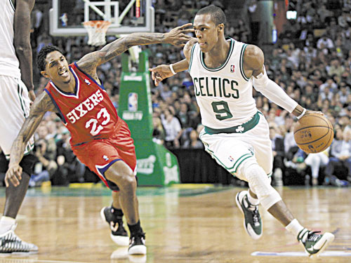 Boston's Rajon Rondo (9) looks for an opening in a game against the Philadelphia 76ers. The Celtics will play exhibition games in October against two of Italy and Turkey's best teams.