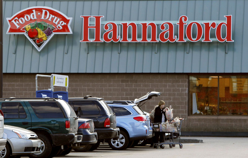 A shopper loads groceries into her car at a Hannaford's grocery store in Auburn. A Hannaford spokesman says signs posted at taffected stores alert customers to the debit and credit card problem.