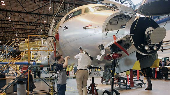 Bombardier employees work on a CRJ200 jet at the company's plant in Montreal.