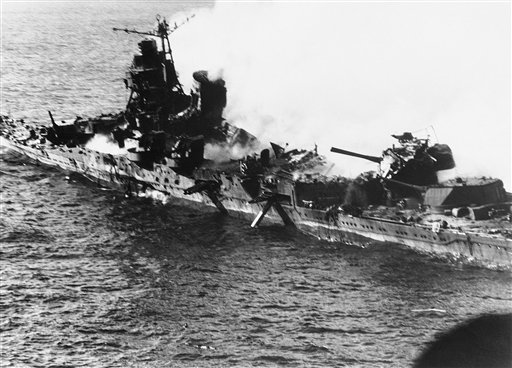 FILE - In this June 1942 file photo, a Mogami class Japanese cruiser is the flaming target of carrier-based U.S. naval aircraft in the historic battle of Midway which raged for three days in June 1942. On Monday, June 4, 2012, the Navy marks the 70th anniversary of a battle that turned the tide of World War II. (AP Photo, file) attack;battle of Midway;battleship;bombing;destruction;fire;Japa