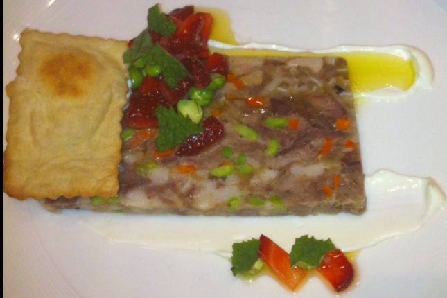 At East Ender, Mitchell Gerow is making a hogs head cheese with peas and strawberries.