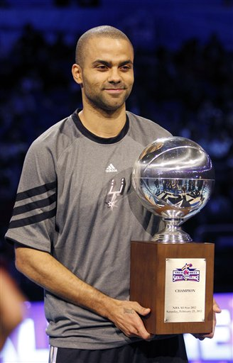 San Antonio Spurs' Tony Parker (9) holds the NBA All-Star Skills Challenge basketball competition trophy after winning the event in Orlando, Fla., Saturday, Feb. 25, 2012. (AP Photo/Lynne Sladky)