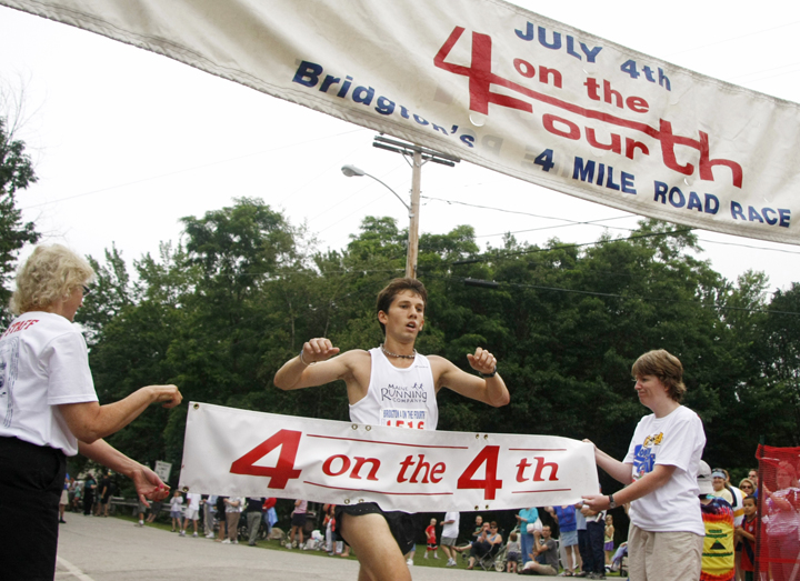 In this file photo, Jonny Wilson of Freeport crosses the finish line in a road race in July 2011. Wilson won the Portland Sea Dogs Father's Day 5K on Sunday, June 17, 2012.