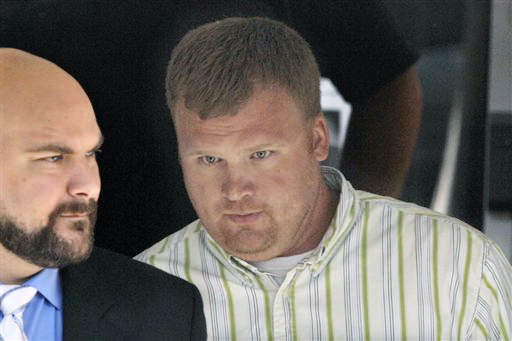 Matt Sandusky, adopted son of Jerry Sandusky, right, leaves the Centre County Courthouse in Bellefonte, Pa. Just a few hours into deliberations on Thursday, Matt Sandusky, came forward for the first time to say in a statement that his father had abused him. The statement didn't detail the abuse allegation.