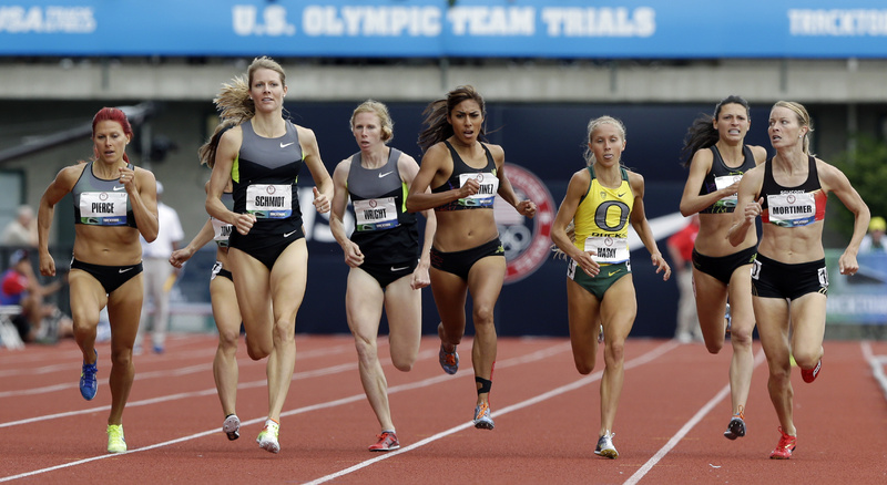 Anna Pierce of Greenwood, left, keeps pace with the leaders heading down the stretch in a 1,500 meters heat Friday and qualified for the finals by finishing fourth. She will be looking for a spot on the Olympic team when she races in the finals Sunday.