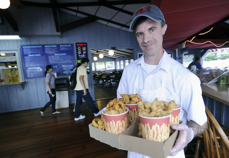 Dave Wilcox, owner of Ken's Place in Scarborough, with a heaping helping of Ken's fried clams, also voted best by readers.