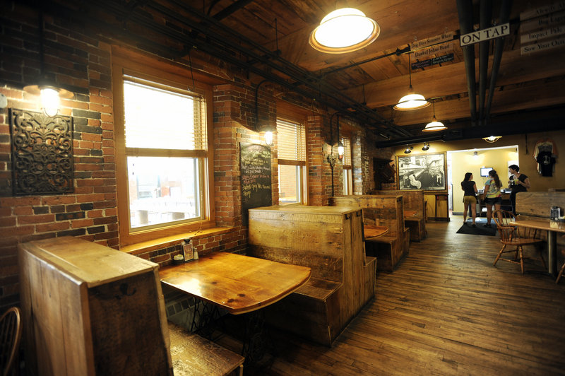 Occupying space in a former textile mill complex in Saco, Run of the Mill Tavern features stout brick walls and rough-hewn furnishings, an in-house brewery and a patio, below, for outdoor dining when the weather turns nice.