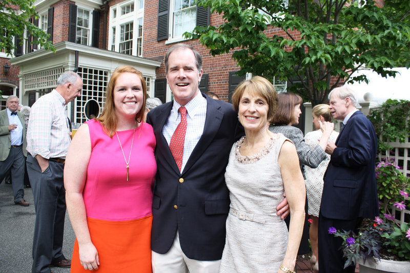 Kat Whelan stands with her parents Bob and Kathy Whelan behind their colonial revival West End home, which was the site of this year's Historic Home Gala.