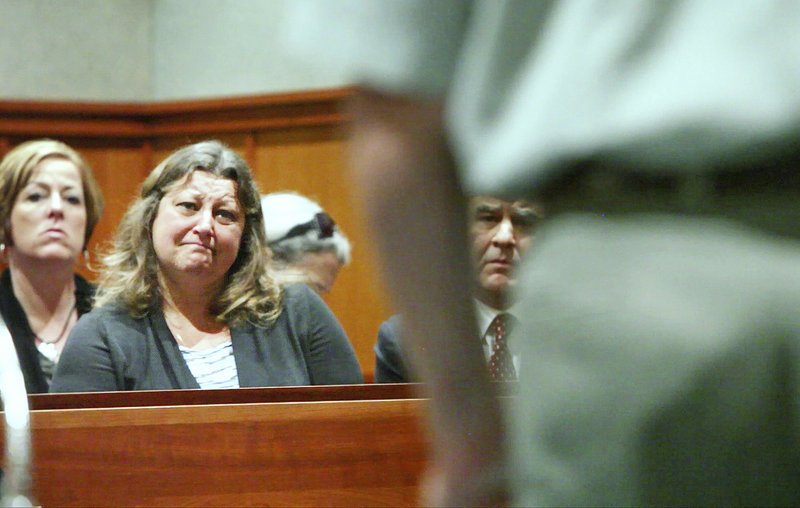 Lisa Kolofsky listens as defendant William Briggs speaks to her during a hearing Thursday in Portland. Briggs pleaded guilty to manslaughter for killing Peter Kolofsky, Lisa's husband, in a hunting accident in Sebago last November.
