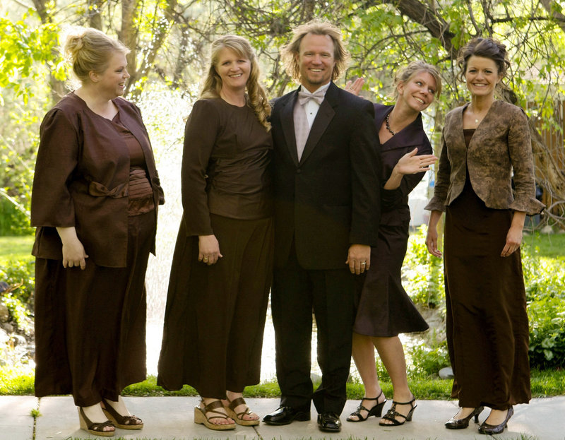 """Kody Brown poses with his wives, from left, Janelle, Christine, Meri, and Robyn, in a promotional photo for TLC's reality TV show, """"Sister Wives."""" The family includes 16 children."""