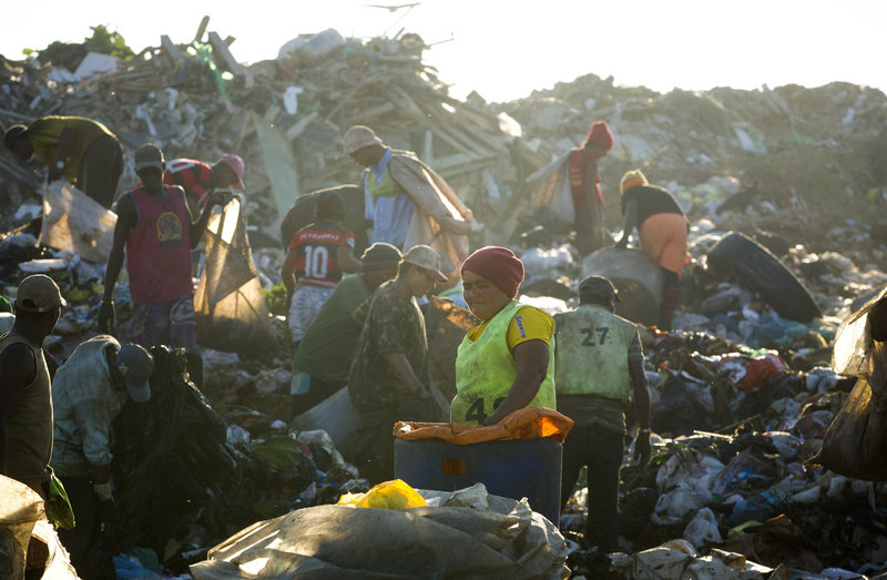 "Trash pickers, or ""catadores,"" collect recyclable materials May 29 at Jardim Gramacho in Rio de Janeiro, Brazil. They will receive a lump-sum payout from the city, but there's no place for them at the new high-tech dump."