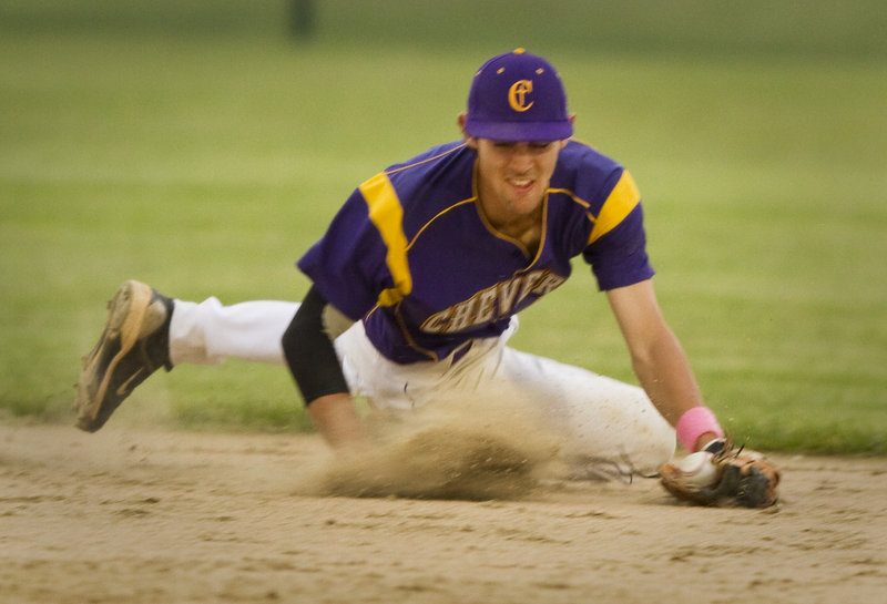 Cheverus shortstop Louie DiStasio makes a diving stab of a ground ball during the Telegram League championship game Friday night against Windham. Cheverus won, 10-8.