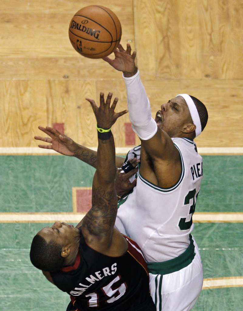 Paul Pierce, blocking a shot by Mario Chalmers of the Miami Heat, was a force in a balanced offense Friday night for the Boston Celtics, scoring 23 points in a had-to-have-it 101-91 victory in Game 3 at Boston.