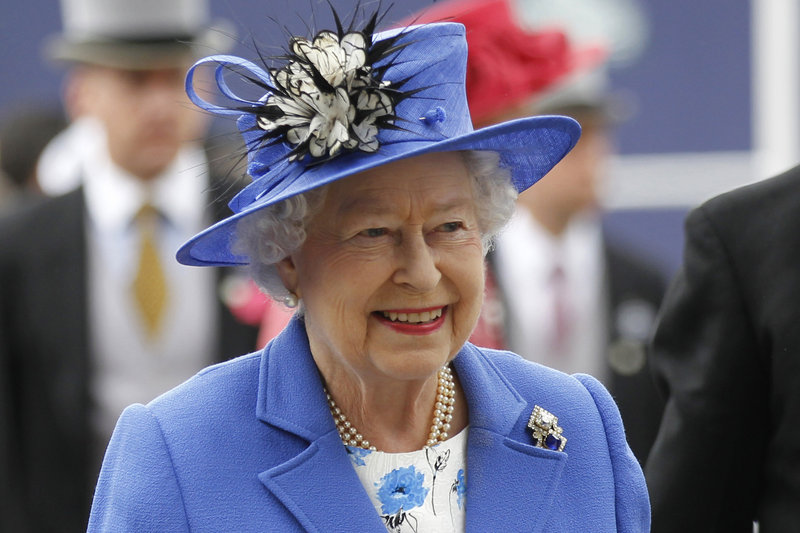 Britain's Queen Elizabeth II arrives for the Epsom Derby at Epsom race course, southern England, at the start of a four-day Diamond Jubilee celebration.