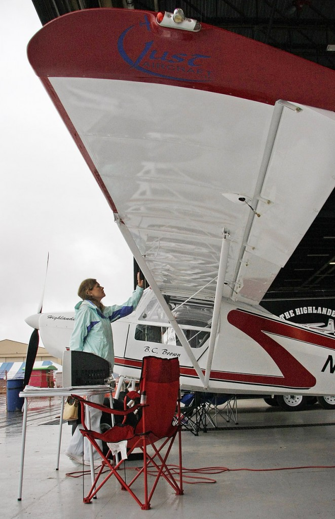 Melissa Niemann of Owls Head examines a Highlander Light Spot experimental aircraft built by Ben Brown of Dixmont at the Brunswick International Fly-In on Saturday.