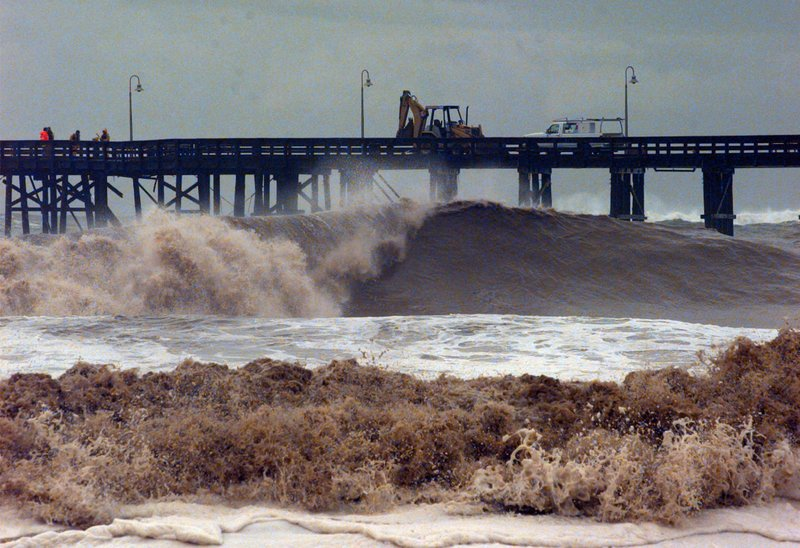 Surf damage is nothing new to Ventura, Calif., residents. In this 1998 photo, work crews repair a damaged pier after a storm struck the Southern California coast.