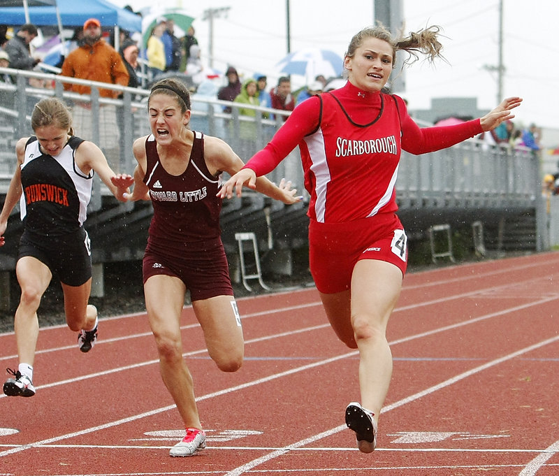 Nicole Kirk of Scarborough zips through the rain Saturday to win the 100 meters in 12.25 seconds in the Class A outdoor track and field state championships Saturday at Windham High. Kirk also came away with a victory in the 200.