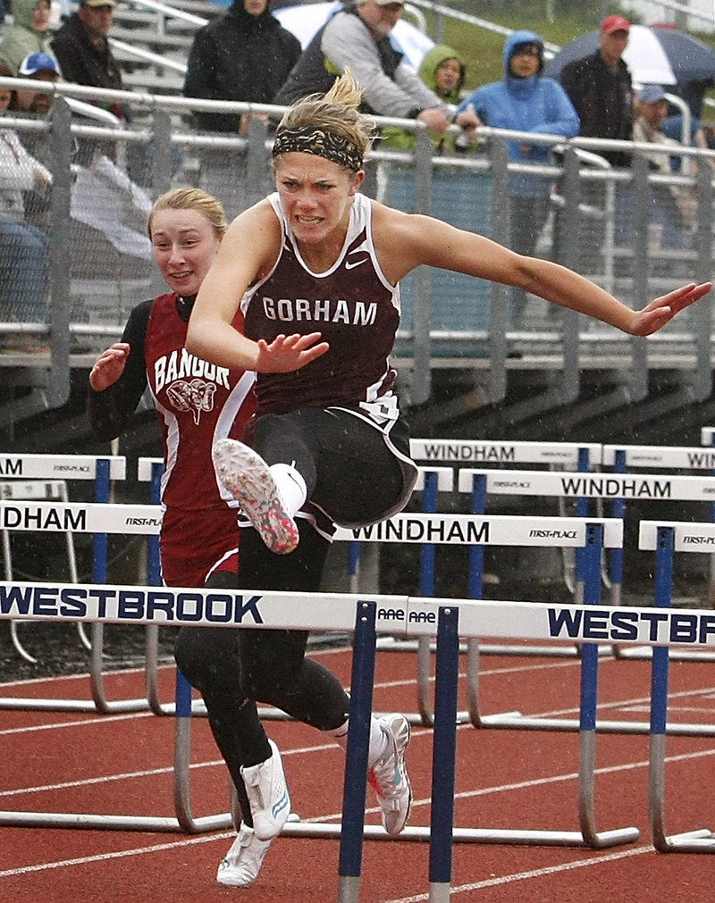 Sarah Perkins of Gorham heads to the finish line Saturday while winning the 100 hurdles in the Class A outdoor track and field championships at Windham High.