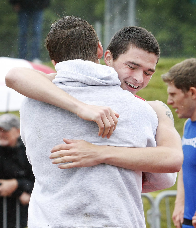 Dan Webb of Sanford receives a hug after capturing the 400 in 49.93 seconds. Sanford hopes to win its first outdoor track state title.