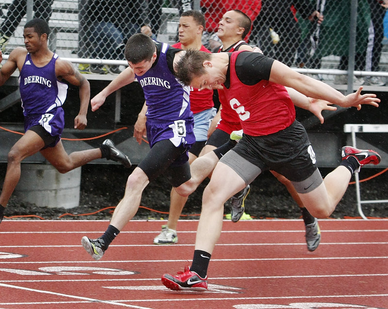Alex Shain of Sanford puts his head down and wins the 100 in 11.33 seconds, beating Matt Kimball of Deering by less than a half-second – a key win if Sanford takes the state title.
