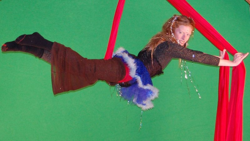 Jenn Bliss, aka Miss Bliss, uses fabric hung from the ceiling as a flying apparatus.