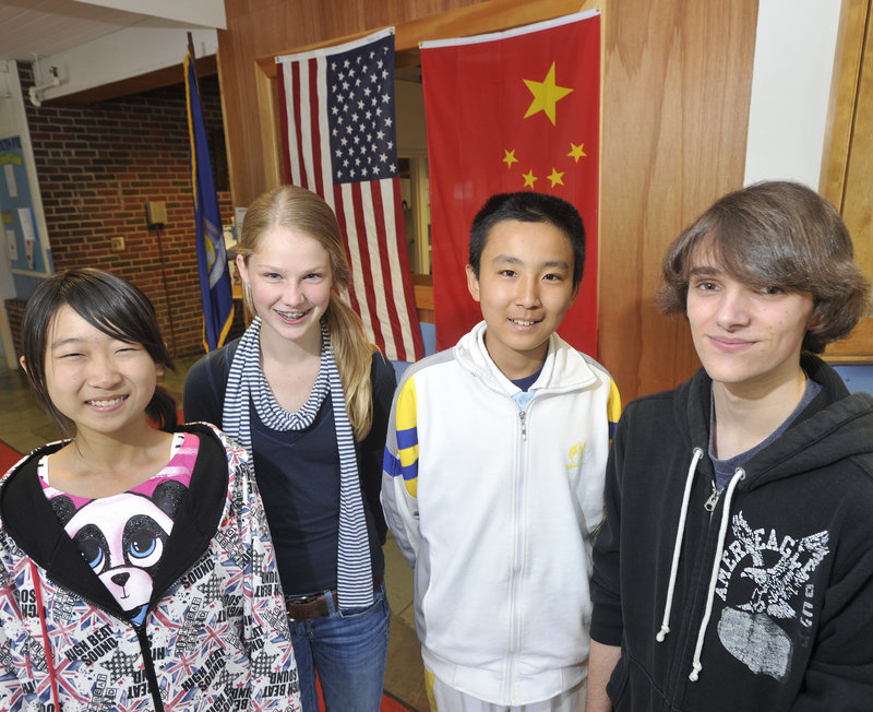 Falmouth student hosts Ben Stimson, right, and Emma Walsh, second from left, stand with their guests, Wang Jinyuan, left, and Geng Haoran. The Chinese students will also visit L.L. Bean in Freeport and Bowdoin College in Brunswick.