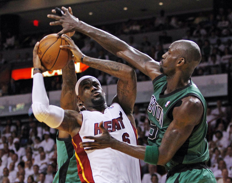 Kevin Garnett, right, is mixing it up on the inside with LeBron James and the Heat as the Celtics are playing with a fervor that belies their age.