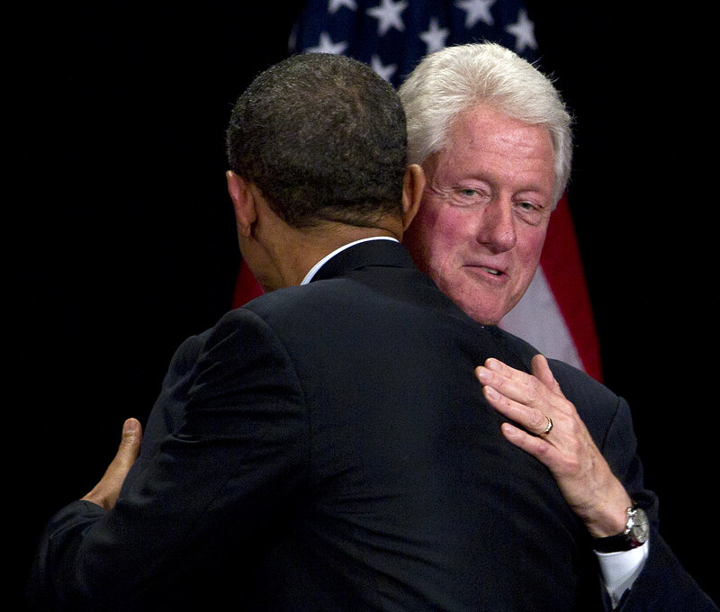 Former President Clinton greets President Obama at a campaign fundraising event in New York on Monday.